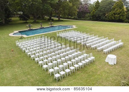 White Chairs Dozens Outdoors