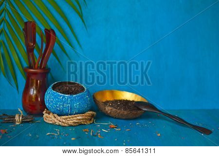 Coconut Bowls With Tea And Green Leaves On Blue Wooden Background.