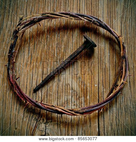 a depiction of the crown of thorns of Jesus Christ and a nail on the Holy Cross