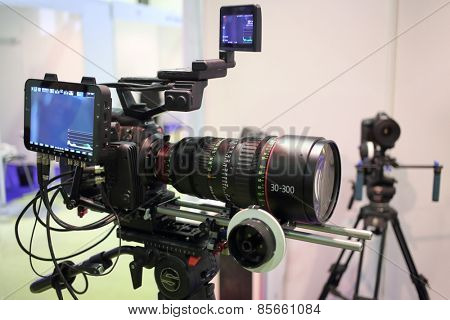 MOSCOW - MAR 12, 2014: Professional digital video camera on a tripod at the exhibition in Expo Center in Moscow, close-up