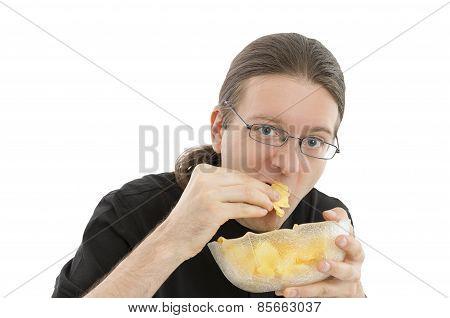 Man Enjoying Chips As Snack