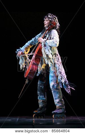 MOSCOW - MAR 12, 2014: Actor Taper-show: dancing on the strings with a cello on roller skates on stage of the Palace on Yauza