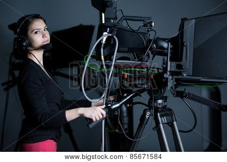 Camerawoman working with big broadcasting camera.Positioned video camera.Behind the scenes
