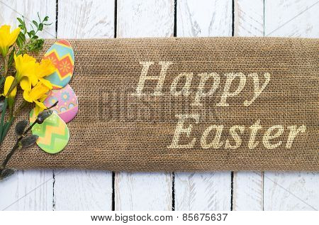 Colorful easter eggs on linen cloth with Happy Easter text poster
