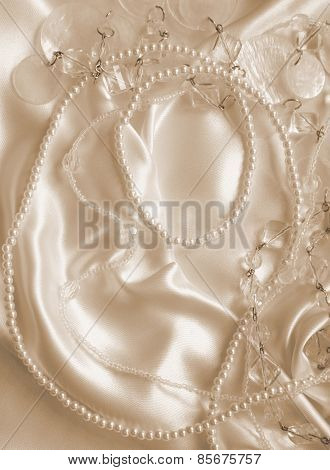 Pearls And Nacreous Beeds On Silk As Wedding Background. In Sepia Toned. Retro Style