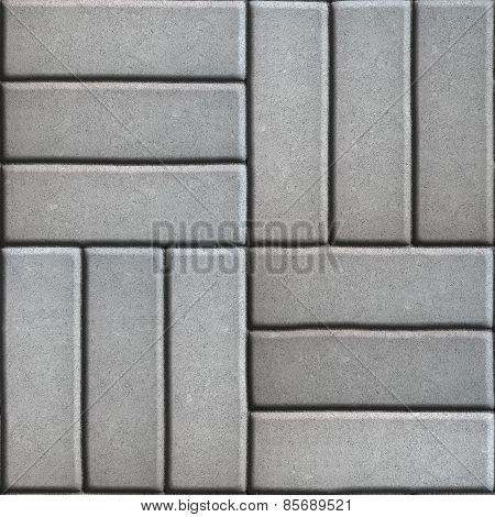 Gray Paving Slabs of Three Rectangles Laid Out Perpendicular to Each Other.