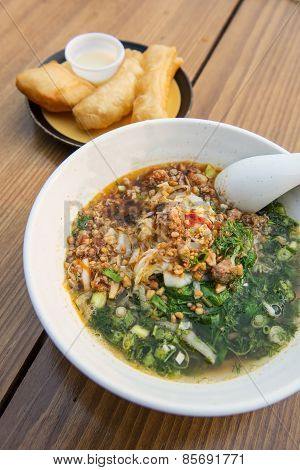 Yunnan rice noodle soup with deep-fried doughstick. poster