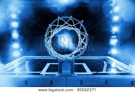 Basketball Hoop in a sports arena (blue toned)