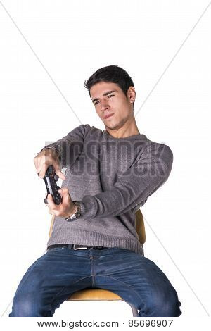 Attractive Young Man Using Joystick Or Joypad For Videogames