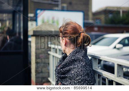 Woman Waiting Outside Car Park