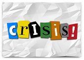 Crisis word in cut out letters on crumpled paper like a ransom note to convey a message of emergency, urgency, bad situation, problem or trouble poster
