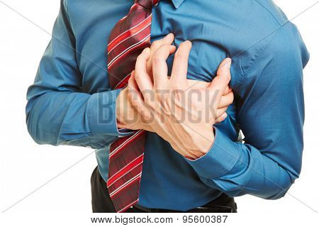 Man having heart attack or coronary and pressing hands to his chest