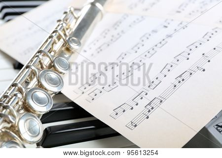 Flute and piano with music sheet close up