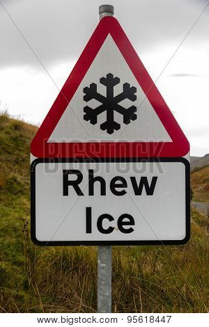 Snowflake Ice Triangular Warning Sign, Bilingual Rhew, Wales, United Kingdom.