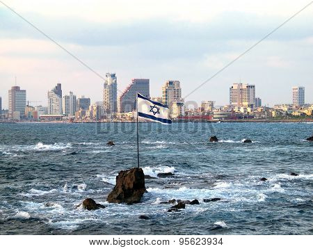 Flag Of Israel On The Andromeda Rocks On The Background Of Tel Aviv