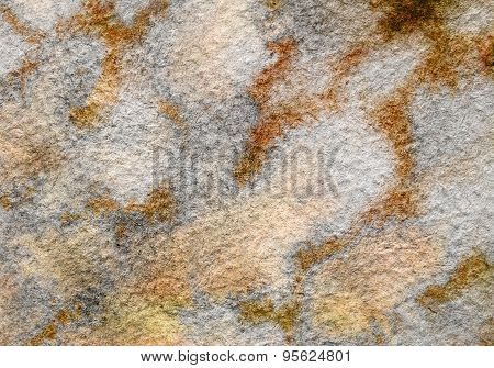 Muted earth tones on textured paper