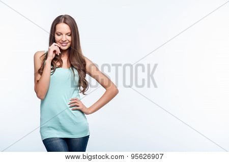 Cheerful shy young woman with pretty smile
