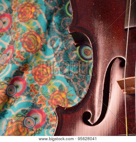 Antique Violin Closeup, Square, Against Intricate Pattern
