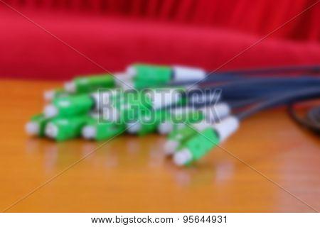 Blurred A Group Head Connector Fiber Optic Green Color On Brown Table.fiber Optics Connectors. Inter