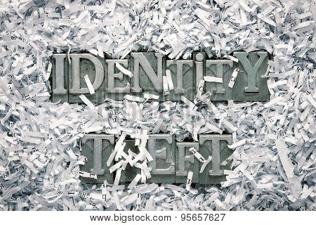 identity theft phrase made from metallic letterpress type inside of shredded paper heap poster