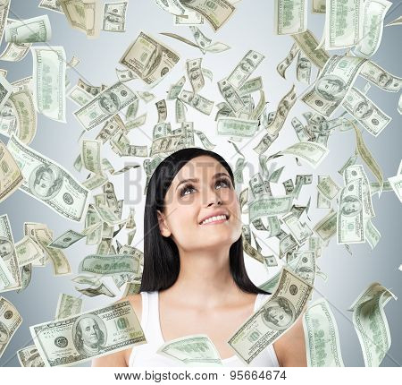 A Portrait Of A Dreamy Brunette Lady In A White Tank Top. Dollar Notes Are Falling From The Ceiling.