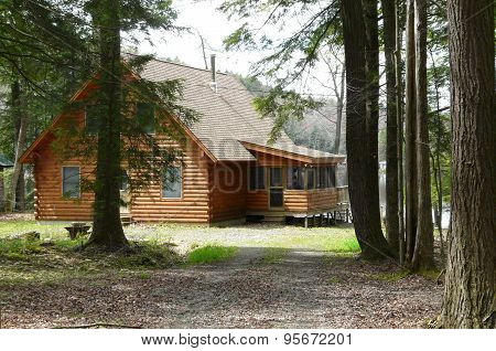 log cabin in the woods on a lake in upstate New York
