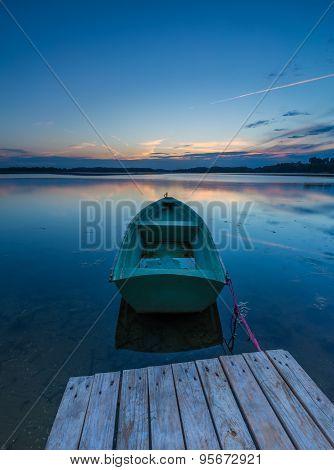 Beautiful Lake Sunset With Fisherman Boats