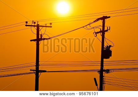 Silhouette Of Electric Pole Power Lines And Wires In Sunset