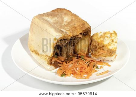 Traditional Durban Bunny Chow Showing Curry Gravy Soaked Bread