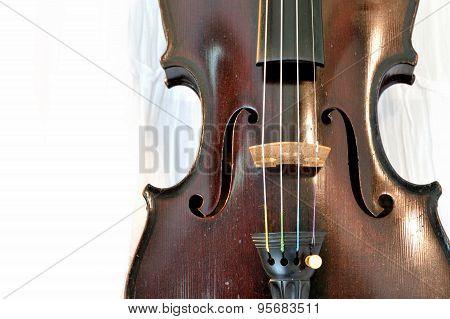 Antique Violin Closeup Against White Fabric