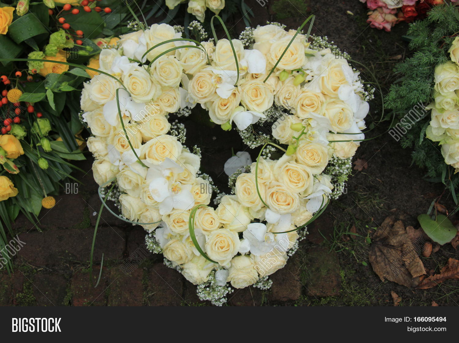 Heart shaped sympathy image photo free trial bigstock heart shaped sympathy or funeral flowers near a tree at a cemetery izmirmasajfo