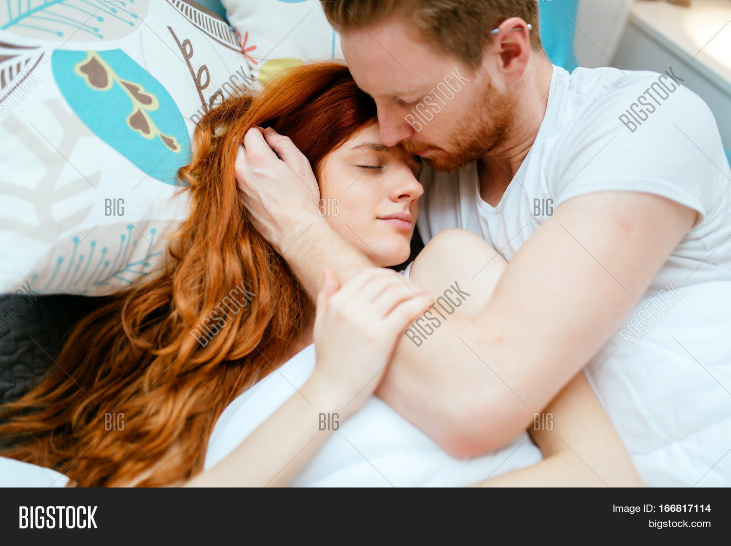 Couple In Love Hugging Kissing Bed