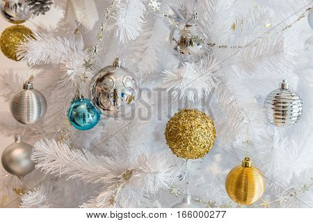 Silver and golden balls garland decoration for christmas and new year festival on white tree