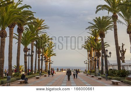 Nerja Spain - december 5 2016: People walking by Europe Balcony promenade Nerja Spain