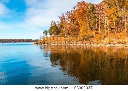 Autumn season at lake with beautiful forest at hill shore. Kentucky USA