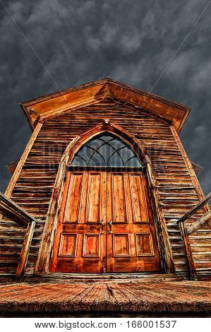 Towering old church entrance from a ghost town