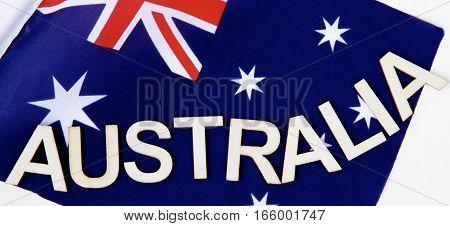 Australian signage on an Australian flag as background.