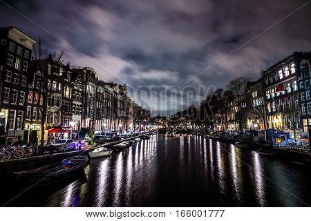 AMSTERDAM NETHERLANDS - JANUARY 12 2017: Beautiful night city canals of Amsterdam. January 12 2017 in Amsterdam - Netherland.