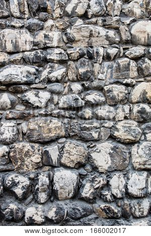 Old black and white stone wall texture background