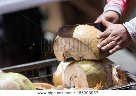 cutting a coconut with machete in Ecuador