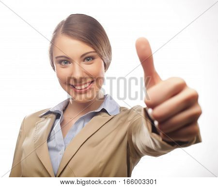 Happy businesswoman making an ok sign isolated on white