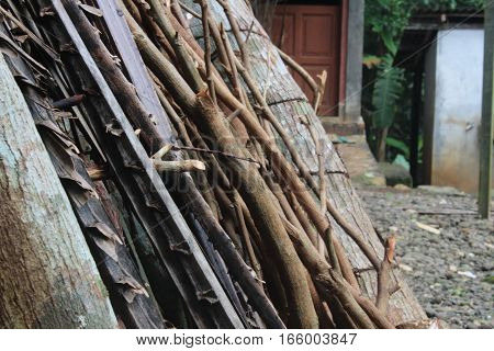 Wood and twig behind the house and the colour is brown