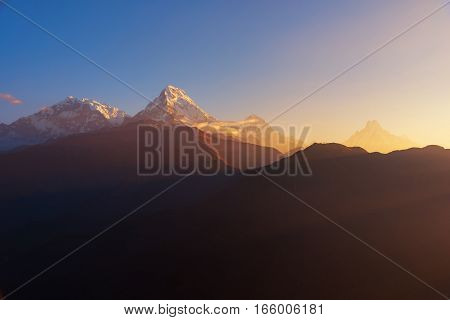 View of Annapurna and Machapuchare peak at Sunrise from Poon Hill, Nepal.