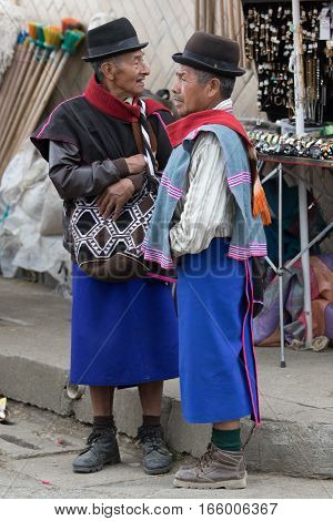 September 6 2016 Silvia Colombia: indigenous Guambiano men wearing traditional skirt outdoors on market day