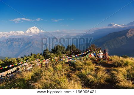 Couple watching the Mt. Dhaulagiri (8,172m) from Poonhill, Nepal.
