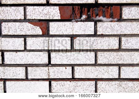 Pattern of White Bricks with One Red Brick