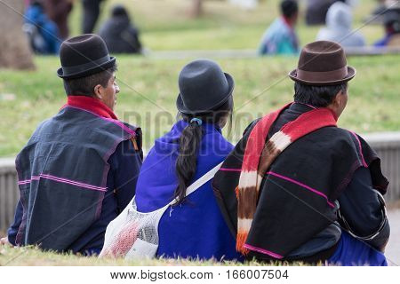 September 6 2016 Silvia Colombia: indigenous Guambiano men and woman sitting outdoors in traditional wear