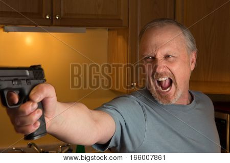 Man with handgun with hostile expression finger on the trigger