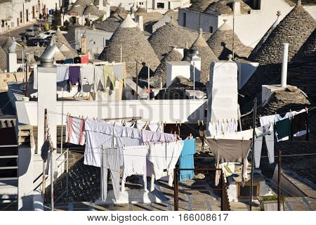 ALBEROBELLO, APULIA, ITALY - JANUARY 02, 2017 - Beautiful view of the traditional trulli houses with their conical roof
