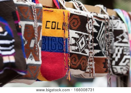 September 6, 2016 Silvia, Colombia: hand knitted indigenous shoilder bags in the artisan market